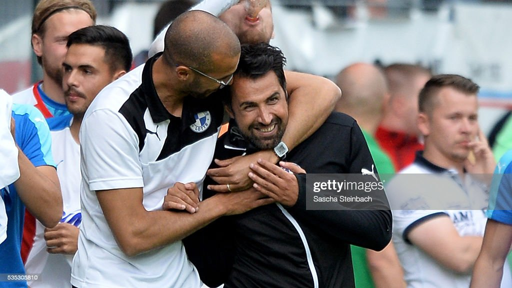 Head coach Ismail Atalan of Lotte celebrates after winning the 3. Liga playoff leg 2 match against Waldhof Mannheim at Carl-Benz-Stadion on May 29, 2016 in Lotte, Germany.