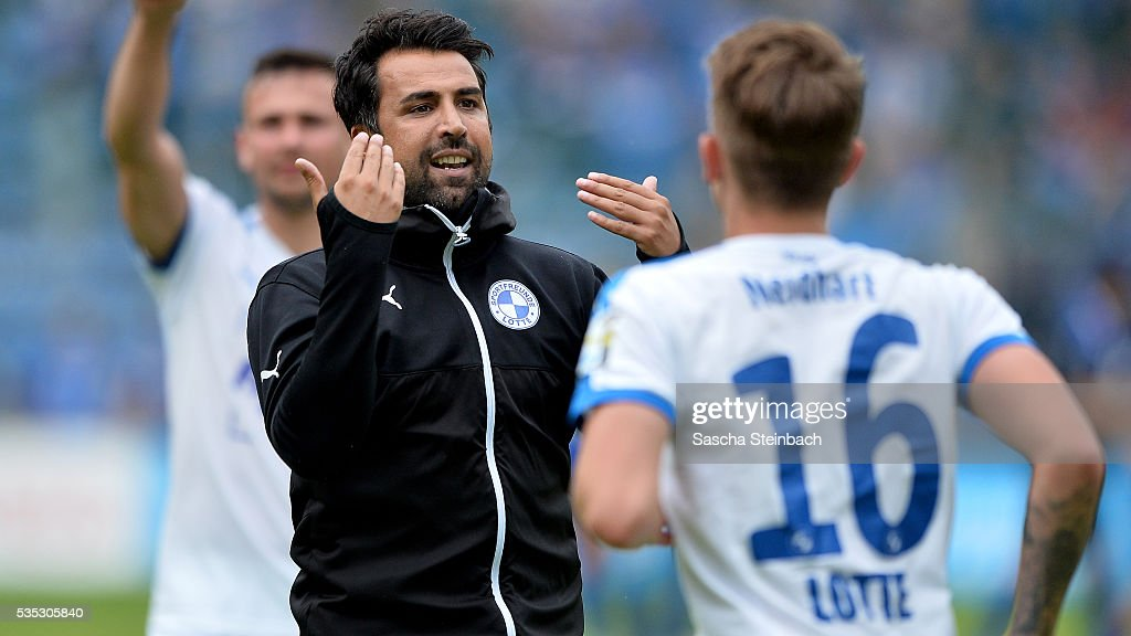 Head coach Ismail Atalan (C) of Lotte reacts after winning the 3. Liga playoff leg 2 match against Waldhof Mannheim at Carl-Benz-Stadion on May 29, 2016 in Lotte, Germany.