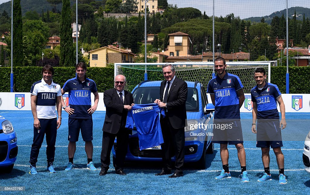 Head Coach Italy <a gi-track='captionPersonalityLinkClicked' href=/galleries/search?phrase=Antonio+Conte&family=editorial&specificpeople=2379002 ng-click='$event.stopPropagation()'>Antonio Conte</a>, <a gi-track='captionPersonalityLinkClicked' href=/galleries/search?phrase=Riccardo+Montolivo&family=editorial&specificpeople=605846 ng-click='$event.stopPropagation()'>Riccardo Montolivo</a>, President FIGC <a gi-track='captionPersonalityLinkClicked' href=/galleries/search?phrase=Carlo+Tavecchio&family=editorial&specificpeople=5365308 ng-click='$event.stopPropagation()'>Carlo Tavecchio</a>, COO FCA Alfredo Altavilla, <a gi-track='captionPersonalityLinkClicked' href=/galleries/search?phrase=Leonardo+Bonucci&family=editorial&specificpeople=6166090 ng-click='$event.stopPropagation()'>Leonardo Bonucci</a> and <a gi-track='captionPersonalityLinkClicked' href=/galleries/search?phrase=Alessandro+Florenzi&family=editorial&specificpeople=7349992 ng-click='$event.stopPropagation()'>Alessandro Florenzi</a> attend Unveil New Panda Azzurri Car at Coverciano on May 26, 2016 in Florence, Italy.