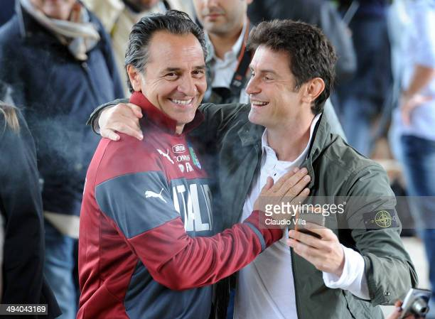 Head coach Italy Cesare Prandelli poses with his fans after a training session at Coverciano on May 27 2014 in Florence Italy
