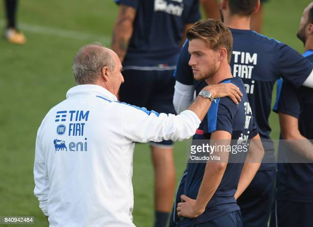 Head coach Italy Gian Piero Ventura and Daniele Rugani chat during the training session at Coverciano on August 30 2017 in Florence Italy