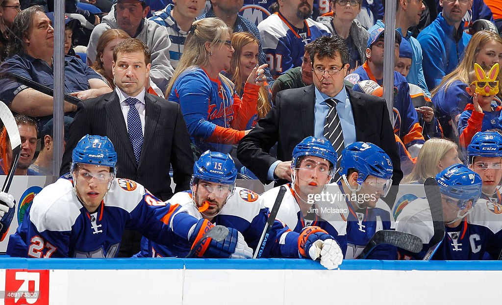Head coach Jack Capuano and assistant coach Doug Weight look on against the Buffalo Sabres on April 4 2015 at Nassau Veterans Memorial Coliseum in...