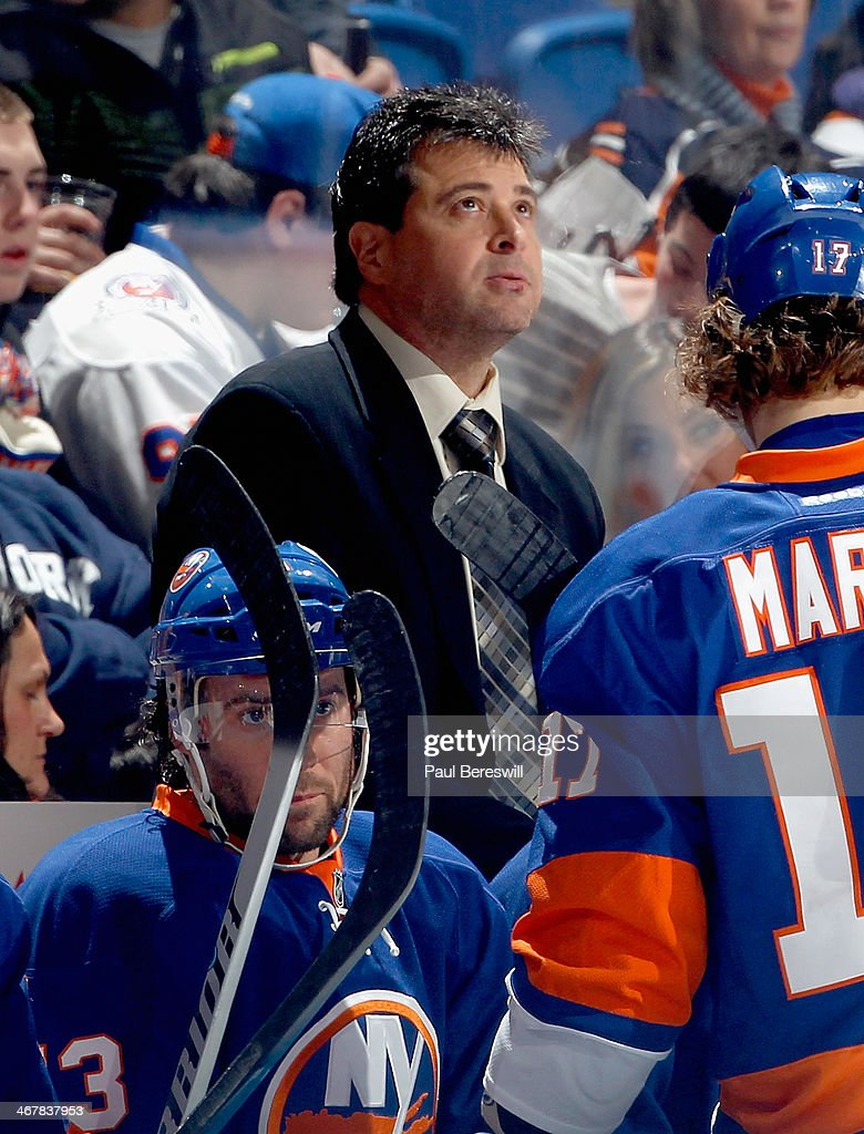 Head coach Jack Capuano of the New York Islanders coaches during an NHL hockey game against the Calgary Flames at Nassau Veterans Memorial Coliseum...