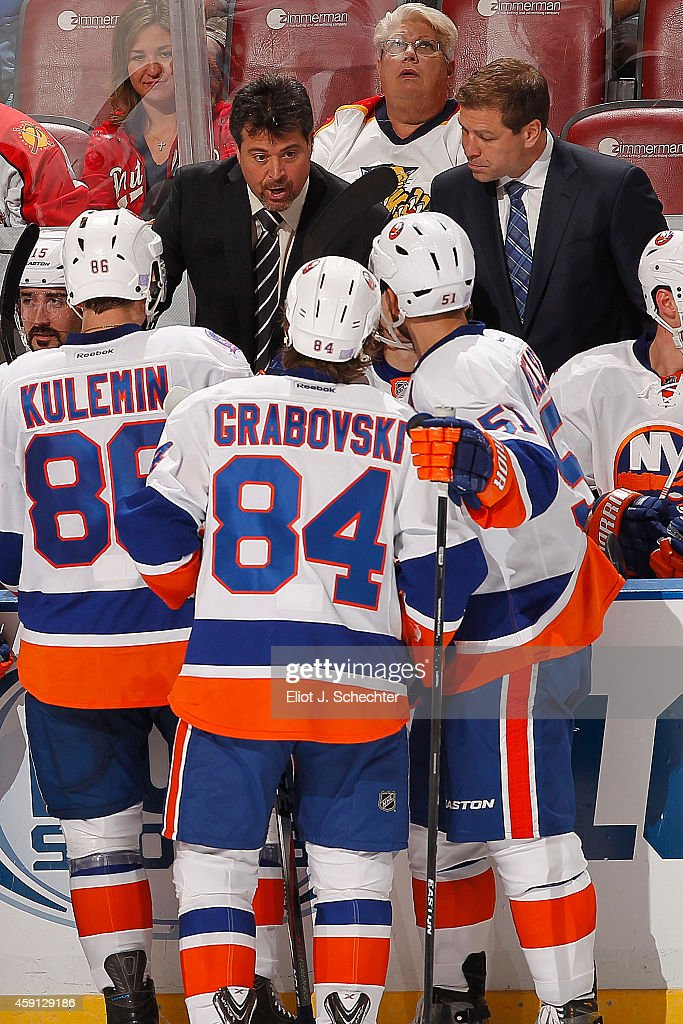 Head Coach Jack Capuano of the New York Islanders directs his team from the bench during a break in the action against Florida Panthers at the BBT...