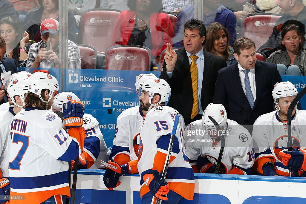 Head coach Jack Capuano of the New York Islanders directs th players during a break in action during the third period against the Florida Panthers in...