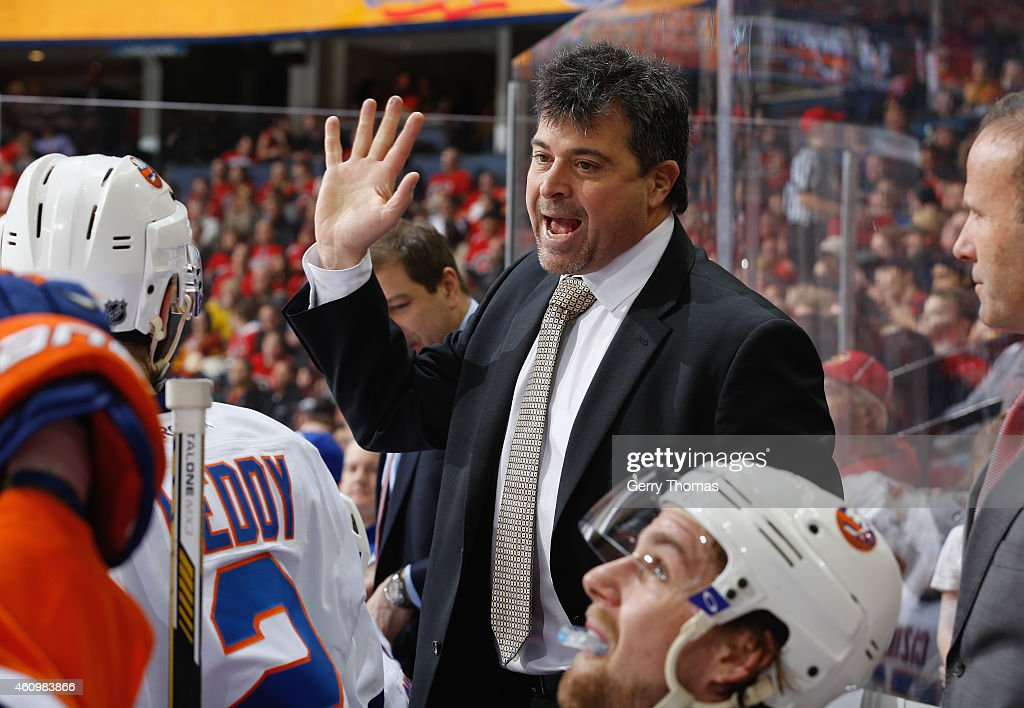 Head coach Jack Capuano of the New York Islanders gives instructions on the bench during the game against the Calgary Flames at Scotiabank Saddledome...