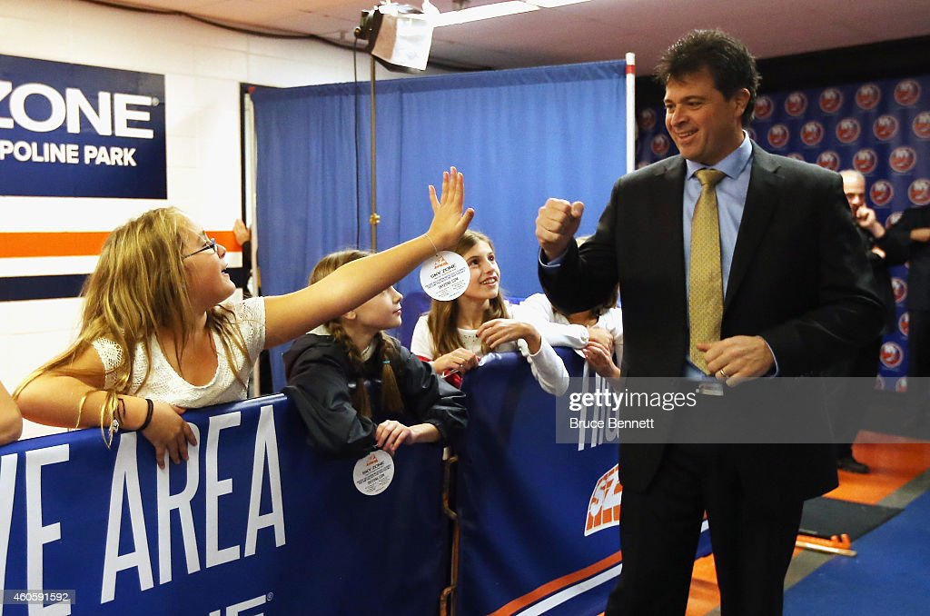 Head coach Jack Capuano of the New York Islanders greets fans prior to the game against the New Jersey Devils at the Nassau Veterans Memorial...