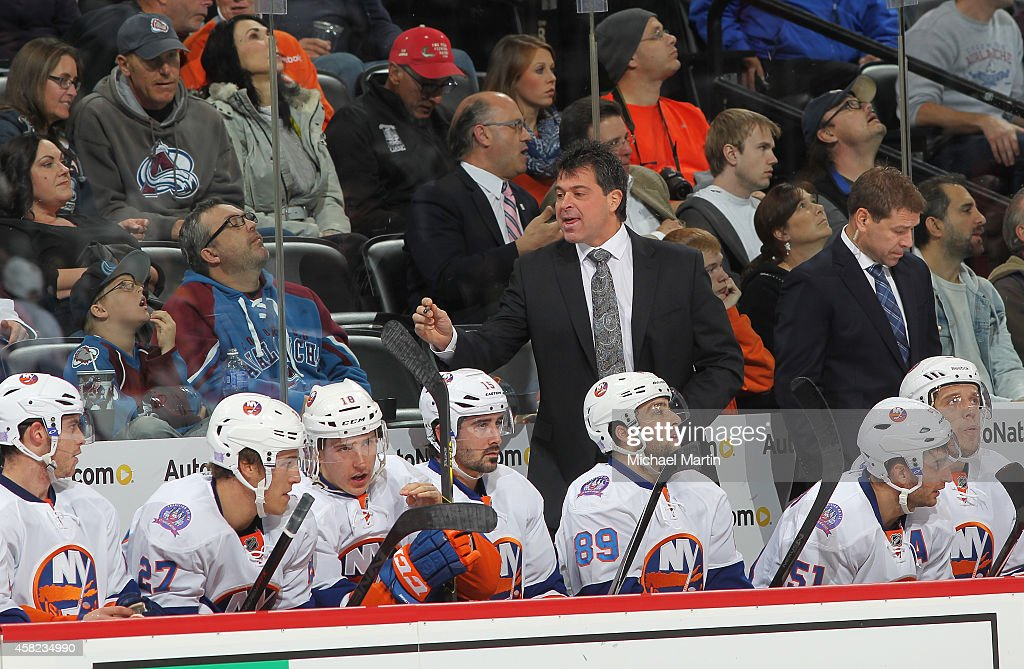 Head Coach Jack Capuano of the New York Islanders leads his team against the Colorado Avalanche at the Pepsi Center on October 30 2014 in Denver...
