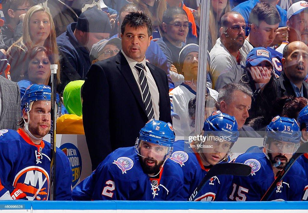 Head coach Jack Capuano of the New York Islanders looks on against the Washington Capitals on December 29 2014 at Nassau Veterans Memorial Coliseum...