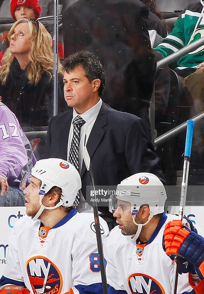 Head coach Jack Capuano of the New York Islanders looks on against the New Jersey Devils during the game at the Prudential Center on October 31 2015...