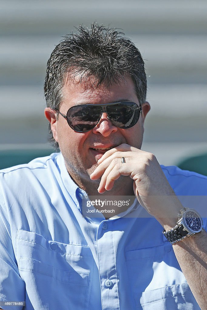 Head coach Jack Capuano of the New York Islanders looks on as his son Anthony Capuano of the Maine Black Bears warms up prior to the game against the...