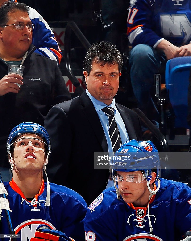 Head coach Jack Capuano of the New York Islanders looks on before a game against the Minnesota Wild on March 24 2015 at Nassau Veterans Memorial...