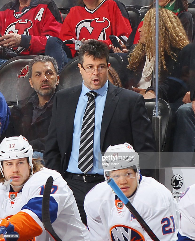 Head coach Jack Capuano of the New York Islanders looks on during the game against the New Jersey Devils at the Prudential Center on January 9 2015...