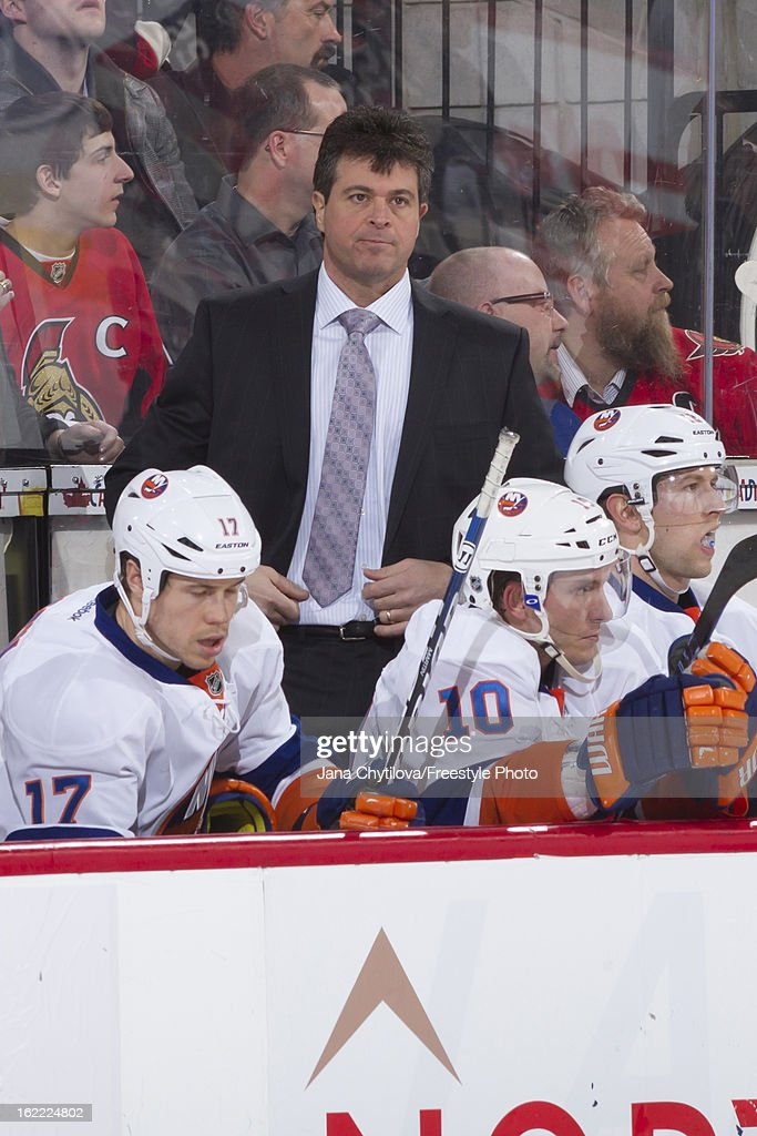 Head coach Jack Capuano of the New York Islanders looks on from the bench during an NHL game against the Ottawa Senators at Scotiabank Place on February 19, 2013 in Ottawa, Ontario, Canada.