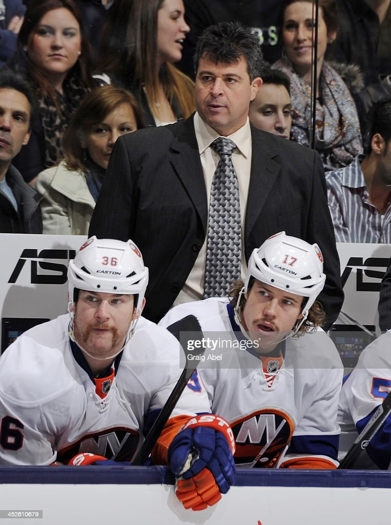 Head Coach Jack Capuano of the New York Islanders looks on from the bench during NHL game action against the Toronto Maple Leafs November 19 2013 at...