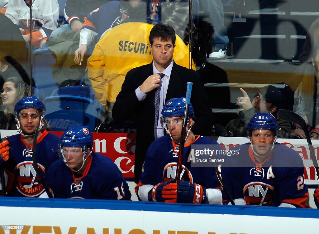 Head coach Jack Capuano of the New York Islanders returns from illness to work the game against the Tampa Bay Lightning at the Nassau Veterans Memorial Coliseum on January 21, 2013 in Uniondale, New York.