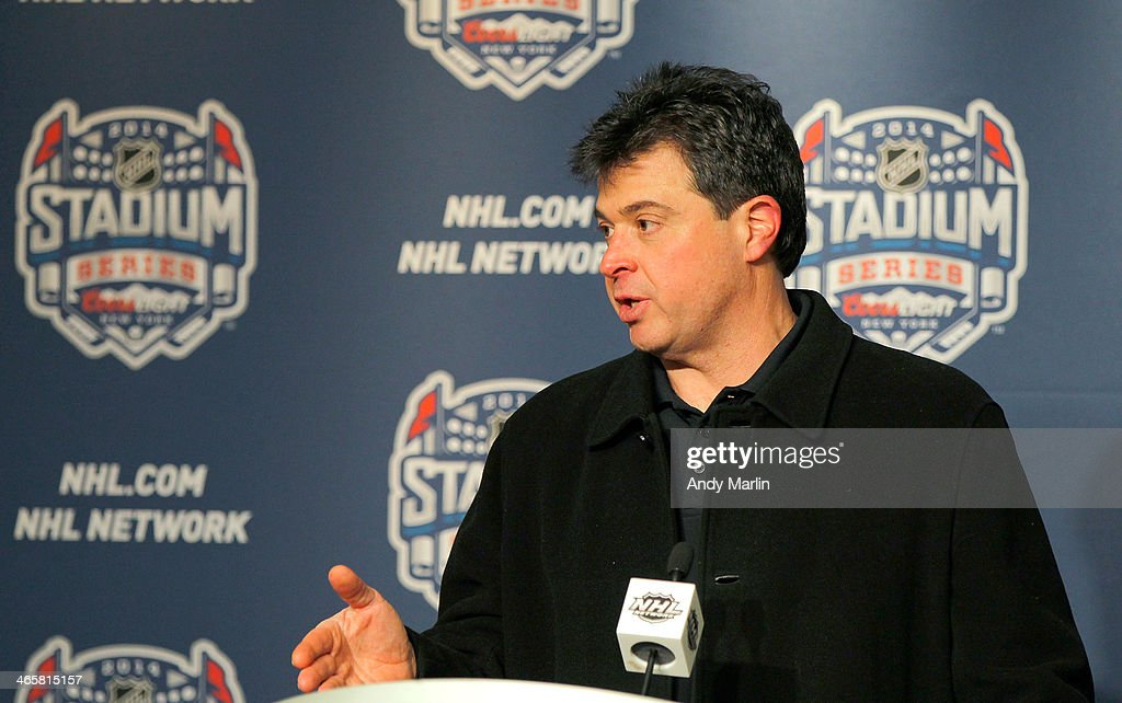 Head Coach Jack Capuano of the New York Islanders speaks at a postgame press conference after the 2014 Coors Light NHL Stadium Series at Yankee...