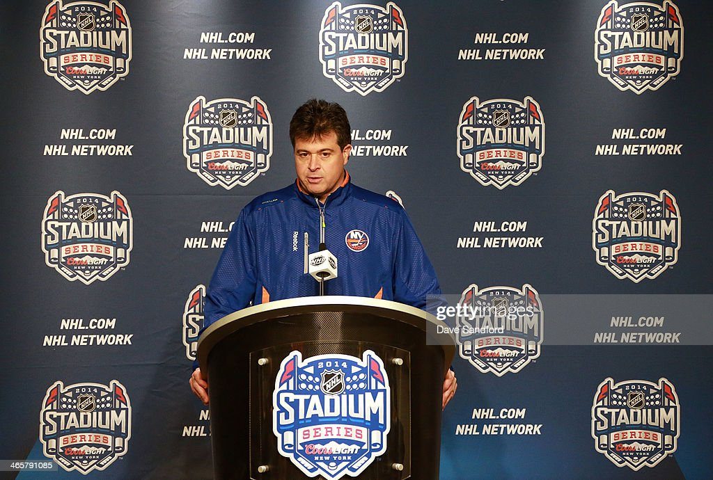 Head Coach Jack Capuano of the New York Islanders speaks at press conference prior to the 2014 Coors Light NHL Stadium Series at Yankee Stadium on...