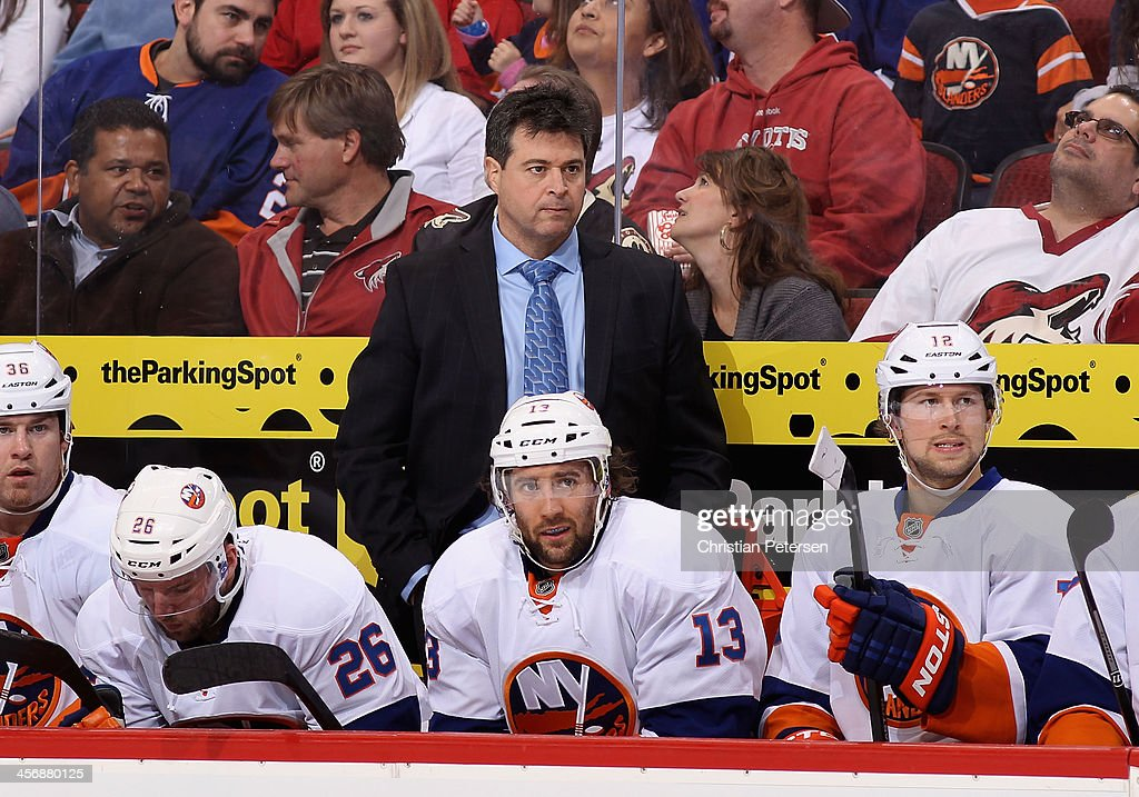 Head coach Jack Capuano of the New York Islanders watches from the bench during the NHL game against the Phoenix Coyotes at Jobingcom Arena on...