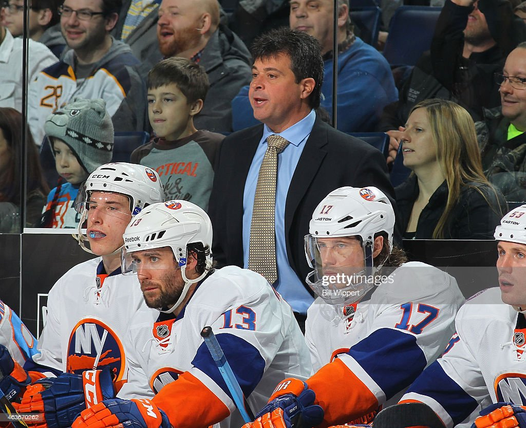 Head coach Jack Capuano of the New York Islanders watches the action against the Buffalo Sabres on February 8 2015 at the First Niagara Center in...