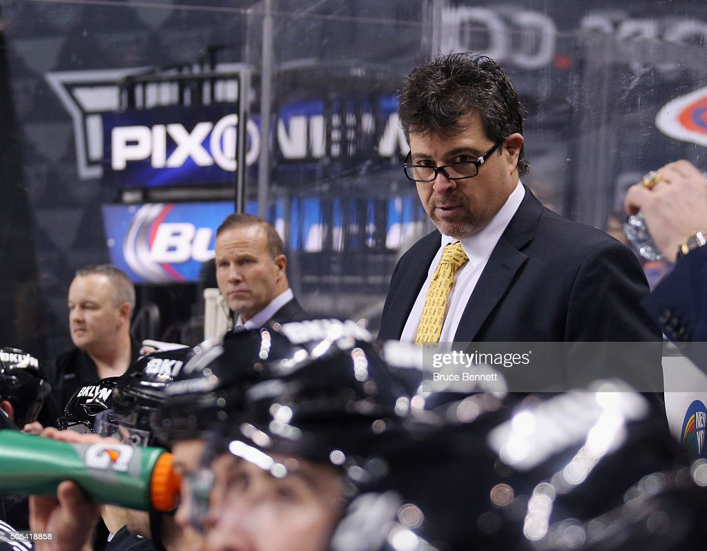 Head coach Jack Capuano of the New York Islanders works the bench against the Vancouver Canucks at the Barclays Center on January 17 2016 in the...