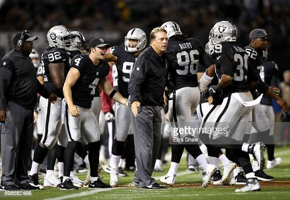 Head coach Jack Del Rio and Derek Carr of the Oakland Raiders congratulate teammates after they forced a safety in their preseason game against the...