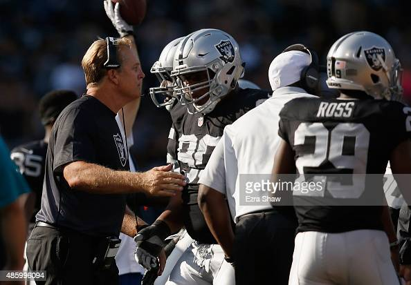 Head coach Jack Del Rio congratulates his players as the come of the field during their game against the Arizona Cardinals at Oco Coliseum on August...