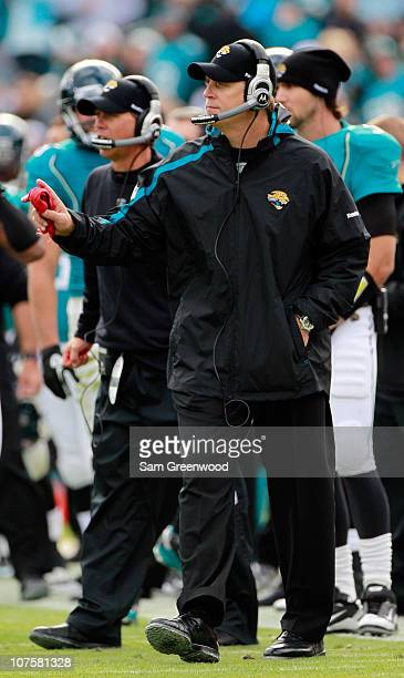 Head coach Jack Del Rio of the Jacksonville Jaguars holds the red challenge flag during the game against the Oakland Raiders at EverBank Field on...