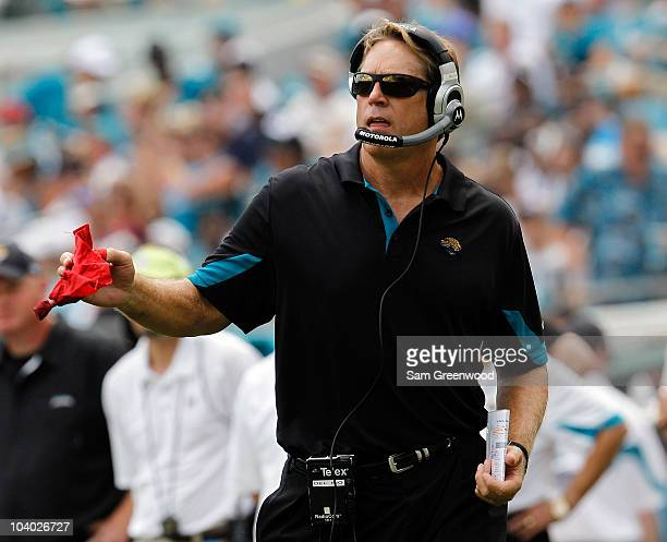 Head coach Jack Del Rio of the Jacksonville Jaguars throws the red challenge flag during the NFL season opener game against the Denver Broncos at...