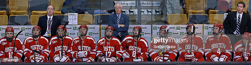 Head coach Jack Parker, center, and his BU Terriers found themselves in an unfamiliar position in the Beanpot, coming in last as they fell in the consolation game to Harvard. They are pictured as they watch the replay of Harvard's sixth goal of the game, which came in the third period and put the Crimson ahead 6-3. Harvard and Boston University met in the consolation game of the Beanpot Tournament at the TD Garden.