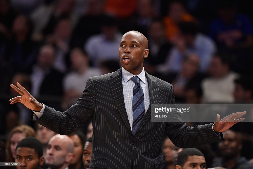 Head coach <a gi-track='captionPersonalityLinkClicked' href=/galleries/search?phrase=Jacque+Vaughn&family=editorial&specificpeople=201747 ng-click='$event.stopPropagation()'>Jacque Vaughn</a> of the Orlando Magic instructs his team during the game against the New York Knicks during their game at Madison Square Garden on November 12, 2014 in New York City.