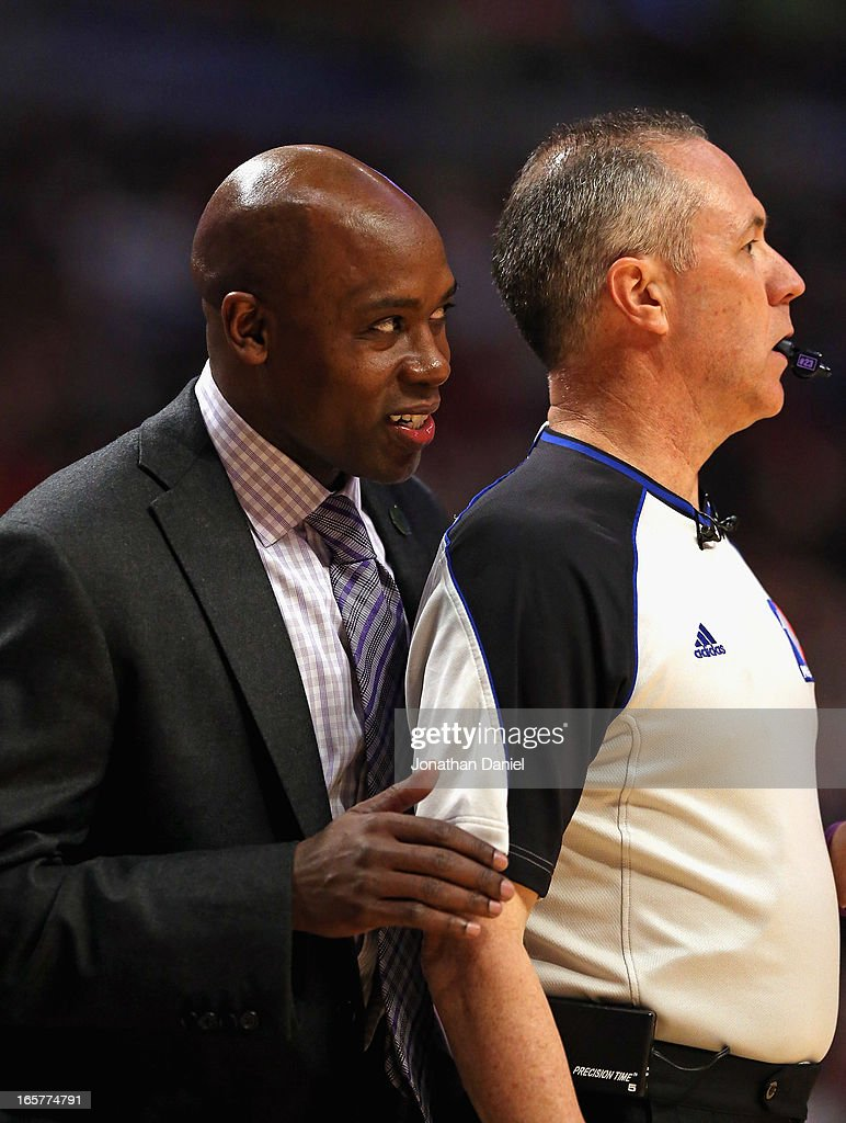 Head coach Jacque Vaughn of the Orlando Magic looks around referee Jason Phillips #23 to watch his team take on the Chicago Bulls at the United Center on April 5, 2013 in Chicago, Illinois. The Bulls defeated the Magic 87-86.