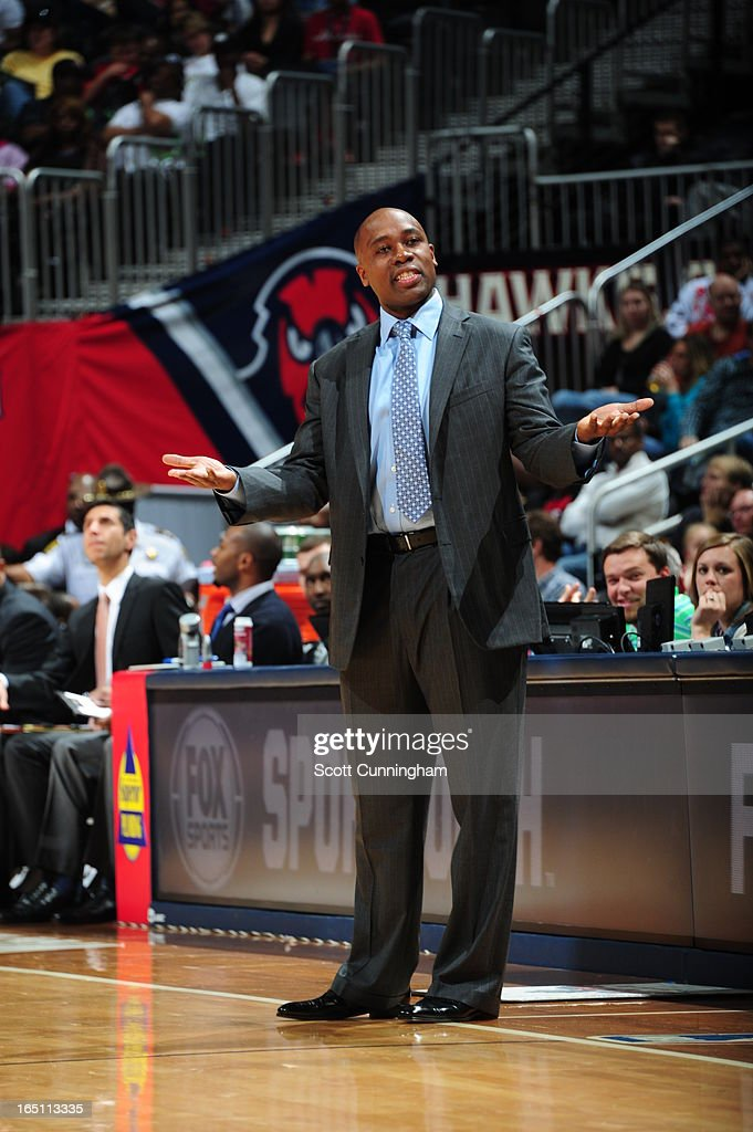 Head Coach <a gi-track='captionPersonalityLinkClicked' href=/galleries/search?phrase=Jacque+Vaughn&family=editorial&specificpeople=201747 ng-click='$event.stopPropagation()'>Jacque Vaughn</a> of the Orlando Magic reacts to a play against the Atlanta Hawks on March 30, 2013 at Philips Arena in Atlanta, Georgia.