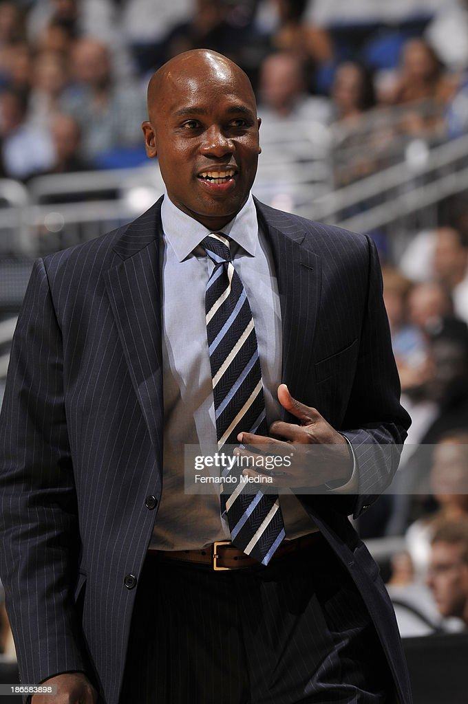 Head Coach <a gi-track='captionPersonalityLinkClicked' href=/galleries/search?phrase=Jacque+Vaughn&family=editorial&specificpeople=201747 ng-click='$event.stopPropagation()'>Jacque Vaughn</a> of the Orlando Magic smiles while looking on against the New Orleans Pelicans during the game on November 1, 2013 at Amway Center in Orlando, Florida.