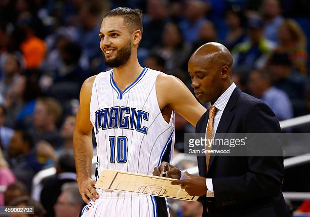 Head coach Jacque Vaughn of the Orlando Magic speaks with Evan Fournier during the game against the Milwaukee Bucks at Amway Center on November 14...