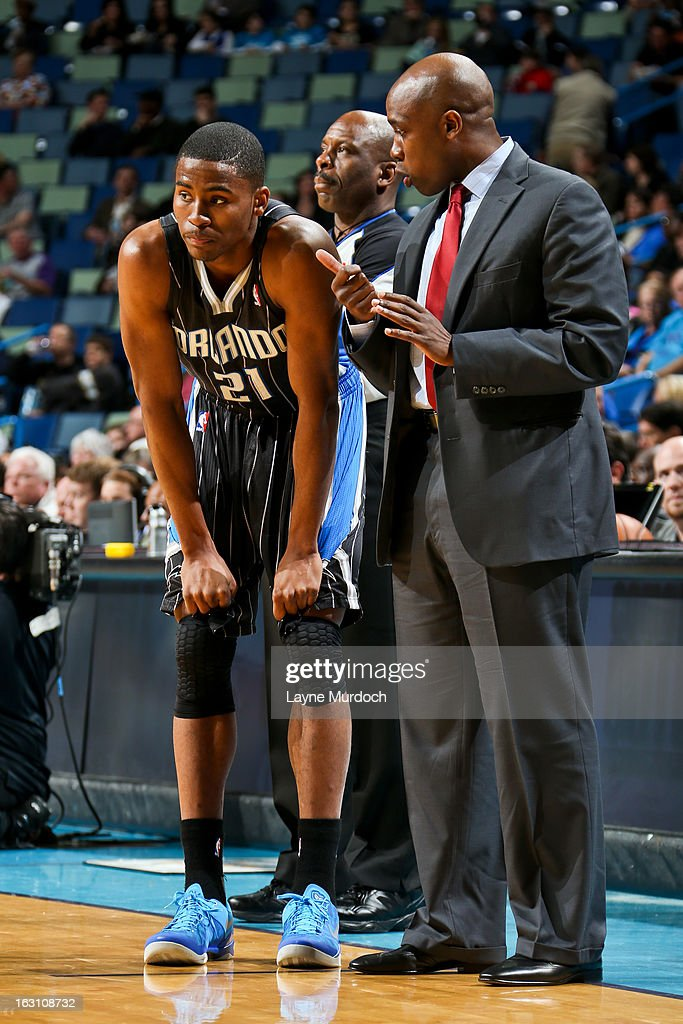 Head Coach Jacque Vaughn of the Orlando Magic speaks with Moe Harkless #21 during a game against the New Orleans Hornets on March 4, 2013 at the New Orleans Arena in New Orleans, Louisiana.