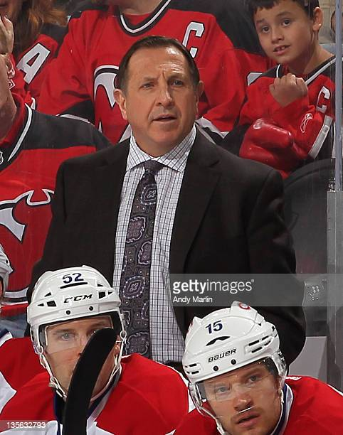 Head coach Jacques Martin of the Montreal Canadiens looks on against the New Jersey Devils during the game at the Prudential Center on December 10...