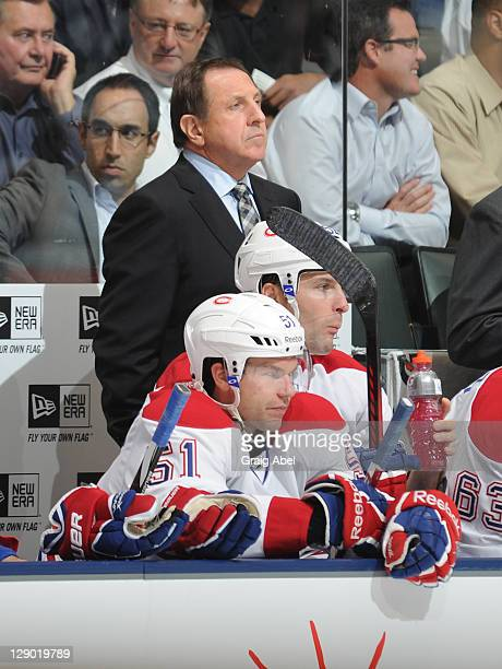 Head Coach Jacques Martin of the Montreal Canadiens looks on from the bench during NHL game action against the Toronto Maple Leafs October 6 2011 at...