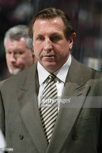 Head coach Jacques Martin of the Ottawa Senators watches the game against the New Jersey Devils at the Continental Airlines Arena on February 3 2004...