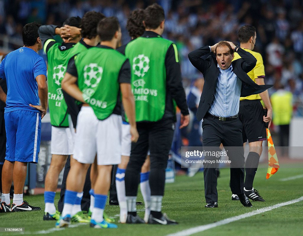 Head coach Jagoba Arrasate of Real Sociedad reacts during the UEFA Champions League Play-offs second leg match between Real Sociedad and Olympique Lyonnais at Estadio Anoeta on August 28, 2013 in San Sebastian, Spain.