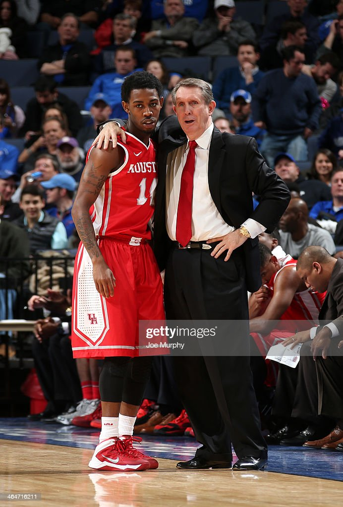 Head coach James Dickey of the Houston Cougars talks to Tione Womack #14 against the Memphis Tigers on January 23, 2014 at FedExForum in Memphis, Tennessee. Memphis beat Houston 82-59.