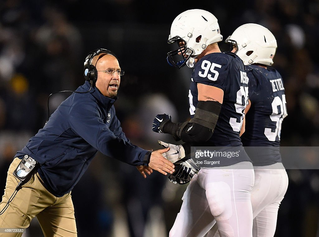 Head coach <a gi-track='captionPersonalityLinkClicked' href=/galleries/search?phrase=James+Franklin+-+American+Football+Coach&family=editorial&specificpeople=12333543 ng-click='$event.stopPropagation()'>James Franklin</a> congratulates <a gi-track='captionPersonalityLinkClicked' href=/galleries/search?phrase=Carl+Nassib&family=editorial&specificpeople=11390627 ng-click='$event.stopPropagation()'>Carl Nassib</a> #95 of the Penn State Nittany Lions after a third down stop against the Michigan State Spartans at Beaver Stadium on November 29, 2014 in State College, Pennsylvania.