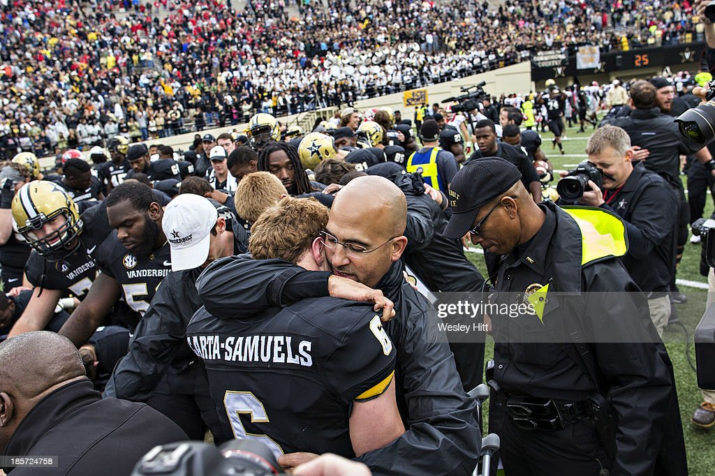 Head Coach James Franklin hugs injured Austyn CartaSamuels of the Vanderbilt Commodores after a game against the Georgia Bulldogs at Vanderbilt...