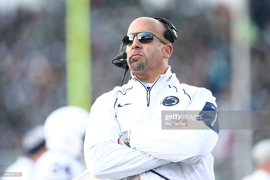 Head coach <a gi-track='captionPersonalityLinkClicked' href=/galleries/search?phrase=James+Franklin+-+American+Football+Coach&family=editorial&specificpeople=12333543 ng-click='$event.stopPropagation()'>James Franklin</a> of the Penn State Nittany Lions looks up at the score board in the first quarter during the game against the Michigan State Spartans at Spartan Stadium on November 28, 2015 in East Lansing, Michigan.