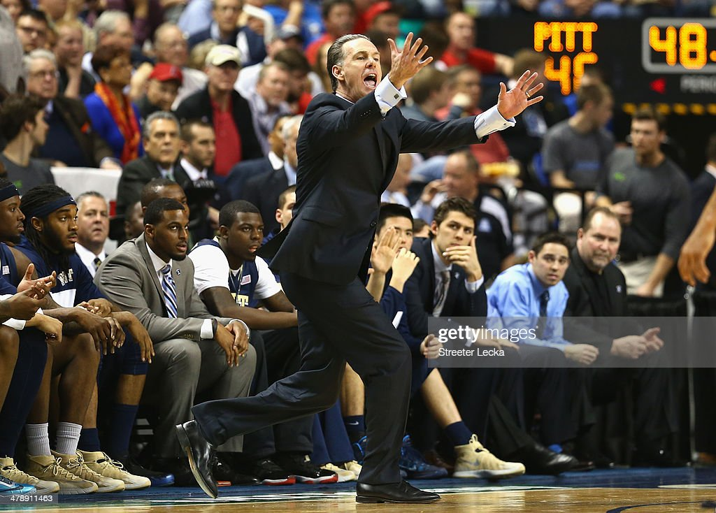 Head coach <a gi-track='captionPersonalityLinkClicked' href=/galleries/search?phrase=Jamie+Dixon&family=editorial&specificpeople=234974 ng-click='$event.stopPropagation()'>Jamie Dixon</a> of the Pittsburgh Panthers reacts against the Virginia Cavaliers during the semifinals of the 2014 Men's ACC Basketball Tournament at Greensboro Coliseum on March 15, 2014 in Greensboro, North Carolina.