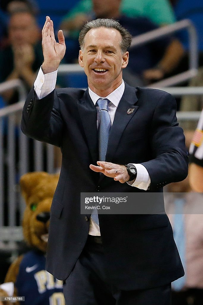 Head coach <a gi-track='captionPersonalityLinkClicked' href=/galleries/search?phrase=Jamie+Dixon&family=editorial&specificpeople=234974 ng-click='$event.stopPropagation()'>Jamie Dixon</a> of the Pittsburgh Panthers reacts in the first half while taking on the Colorado Buffaloes during the second round of the 2014 NCAA Men's Basketball Tournament at Amway Center on March 20, 2014 in Orlando, Florida.