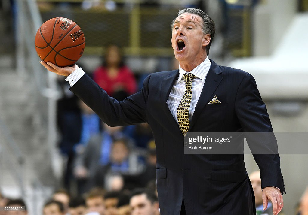 Head coach <a gi-track='captionPersonalityLinkClicked' href=/galleries/search?phrase=Jamie+Dixon&family=editorial&specificpeople=234974 ng-click='$event.stopPropagation()'>Jamie Dixon</a> of the Pittsburgh Panthers reacts to a play while holding the ball against the Syracuse Orange during the first half at the Petersen Events Center on December 30, 2015 in Pittsburgh, Pennsylvania.