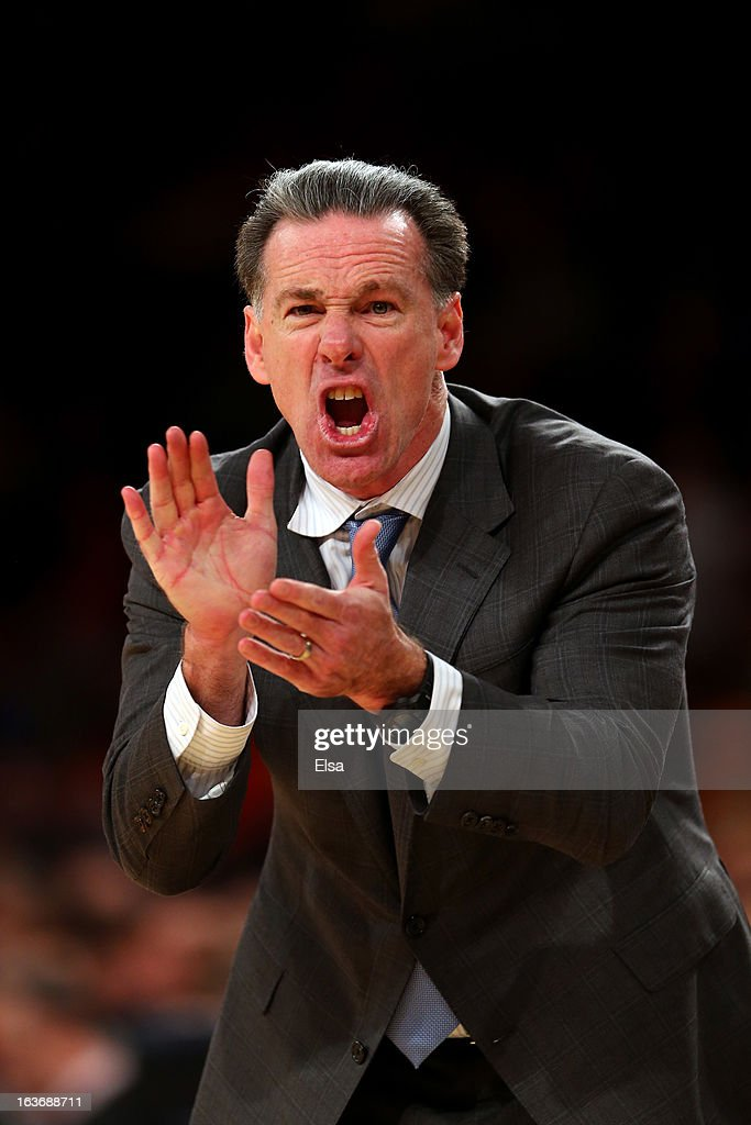 Head coach <a gi-track='captionPersonalityLinkClicked' href=/galleries/search?phrase=Jamie+Dixon&family=editorial&specificpeople=234974 ng-click='$event.stopPropagation()'>Jamie Dixon</a> of the Pittsburgh Panthers reaxcts as he coaches against the Syracuse Orange during the quaterfinals of the Big East Men's Basketball Tournament at Madison Square Garden on March 14, 2013 in New York City.