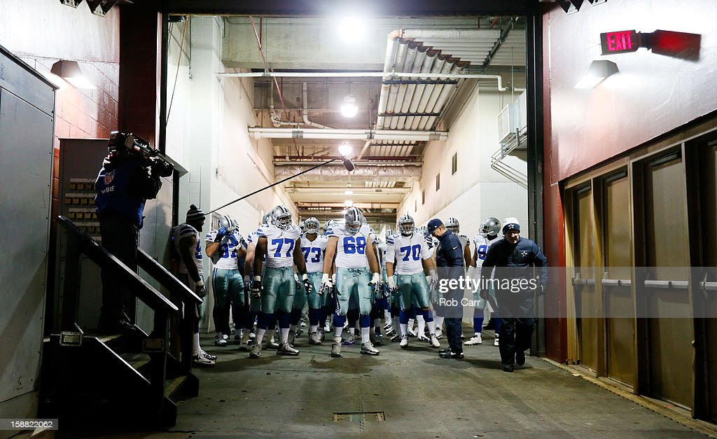 Head coach Jason Garrett and the Dallas Cowboys prepare to take the field for their game against the Washington Redskins at FedExField on December 30, 2012 in Landover, Maryland.