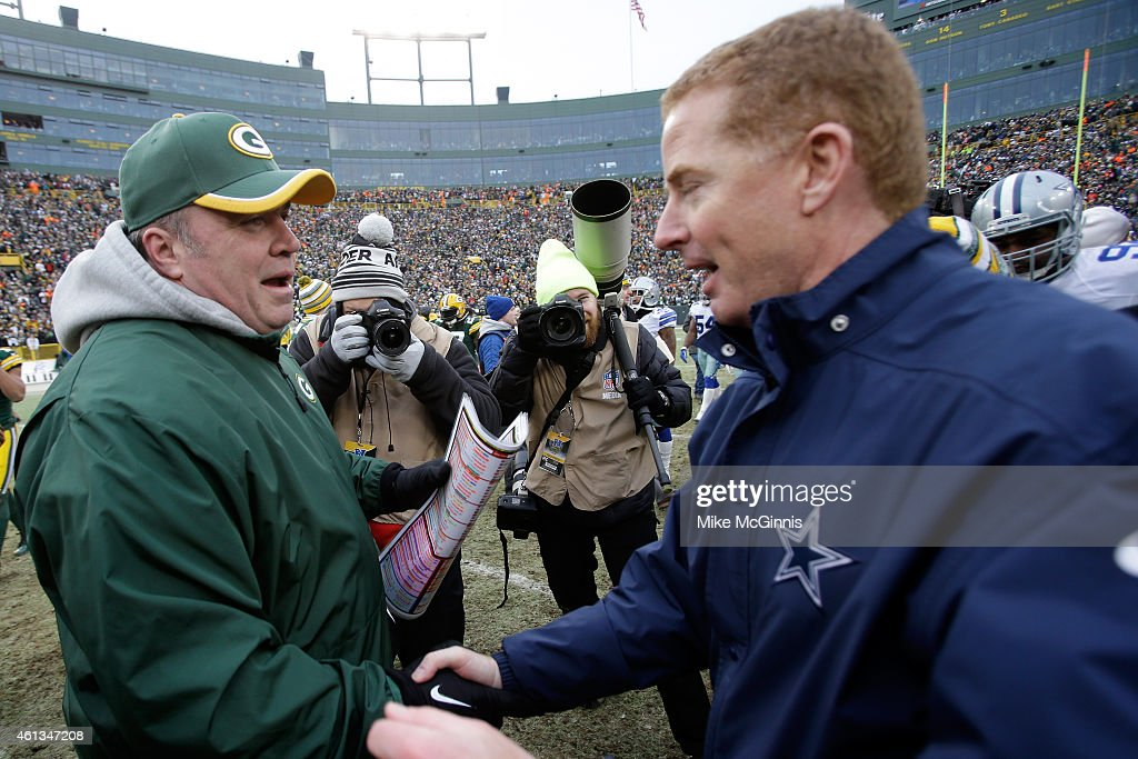 Head coach Jason Garrett of the Dallas Cowboys congratulates head coach Mike McCarthy of the Green Bay Packers after the 2015 NFC Divisional Playoff game at Lambeau Field on January 11, 2015 in Green Bay, Wisconsin. The Packers defeated the Cowboys 26-21.